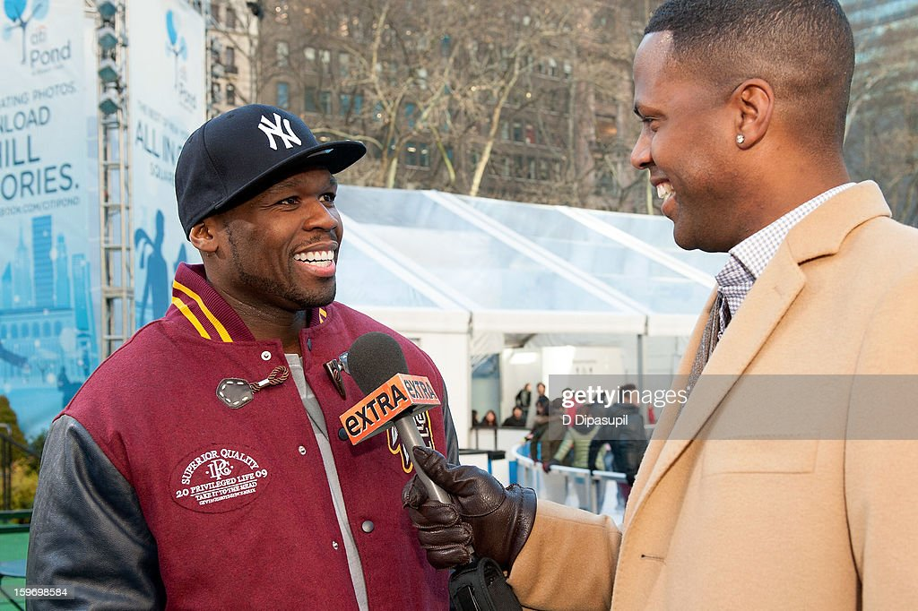 AJ Calloway (R) interviews <a gi-track='captionPersonalityLinkClicked' href=/galleries/search?phrase=50+Cent+-+Rapper&family=editorial&specificpeople=215363 ng-click='$event.stopPropagation()'>50 Cent</a> during his visit to 'Extra' at Bryant Park on January 18, 2013 in New York City.