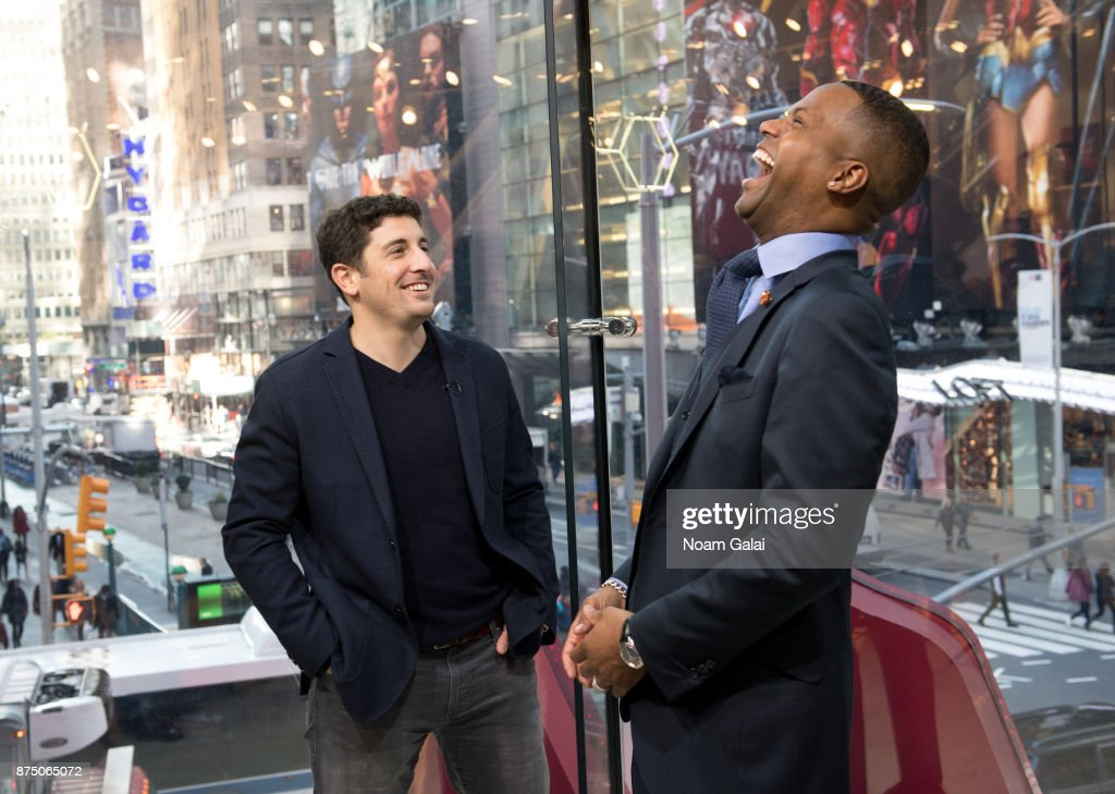 AJ Calloway (R) interviews actor Jason Biggs during his visit to 'Extra' at their New York studios at H&M Times Square on November 16, 2017 in New York City.
