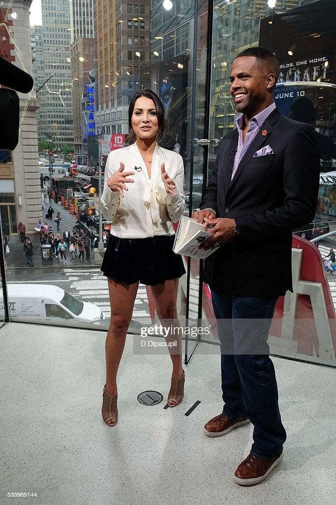 AJ Calloway (R) interviews <a gi-track='captionPersonalityLinkClicked' href=/galleries/search?phrase=Andi+Dorfman&family=editorial&specificpeople=12541836 ng-click='$event.stopPropagation()'>Andi Dorfman</a> during her visit to 'Extra' at their New York studios at H&M in Times Square on May 24, 2016 in New York City.