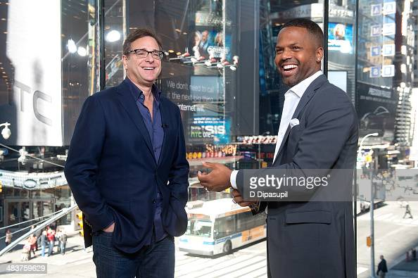Calloway interviews Bob Saget during his visit to 'Extra' at their New York studios at HM in Times Square on April 10 2014 in New York City