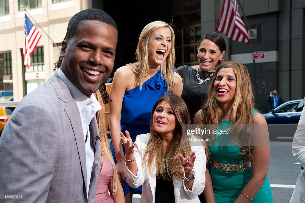 AJ Calloway (L) interviews (R-L) Chanel 'Coco' Omari, Erica Gimbel, Ashlee White, and Casey Cohen of 'The Princesses Of Long Island' during their visit to 'Extra' in Times Square on May 30, 2013 in New York City.