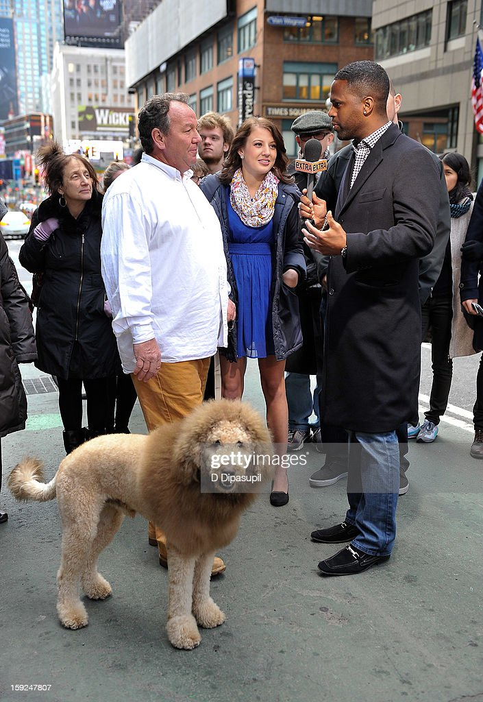 AJ Calloway (R) interviews Charles the Monarch owner Daniel Painter (L) and daughter Natalie Painter during a taping of 'Extra' in Times Square on January 10, 2013 in New York City.