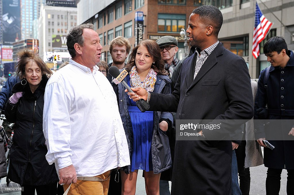 AJ Calloway (R) interviews Charles the Monarch owner Daniel Painter during a taping of 'Extra' in Times Square on January 10, 2013 in New York City.