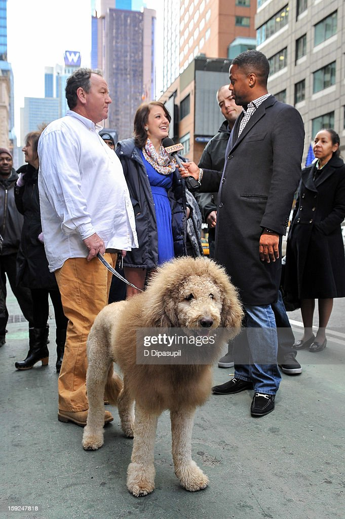 AJ Calloway (R) interviews Charles the Monarch owners Daniel Painter (L) and daughter Natalie Painter during a taping of 'Extra' in Times Square on January 10, 2013 in New York City.