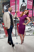 Calloway interviews Debra Messing during her visit to 'Extra' at their New York studios at HM in Times Square on September 21 2015 in New York City