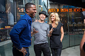AJ Calloway interviews Donnie Wahlberg and Jenny McCarthy during their visit to 'Extra' at their New York studios at HM in Times Square on June 15...
