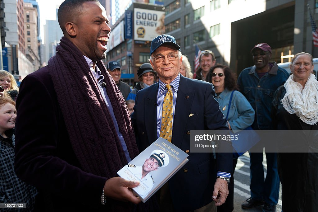 AJ Calloway (L) interviews <a gi-track='captionPersonalityLinkClicked' href=/galleries/search?phrase=Gavin+MacLeod&family=editorial&specificpeople=228310 ng-click='$event.stopPropagation()'>Gavin MacLeod</a> during his visit to 'Extra' in Times Square on October 24, 2013 in New York City.