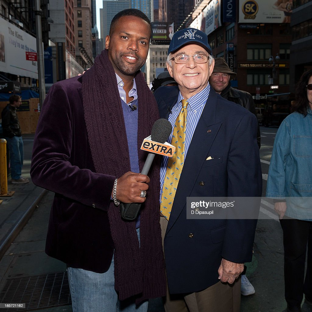 AJ Calloway (L) interviews Gavin MacLeod during his visit to 'Extra' in Times Square on October 24, 2013 in New York City.