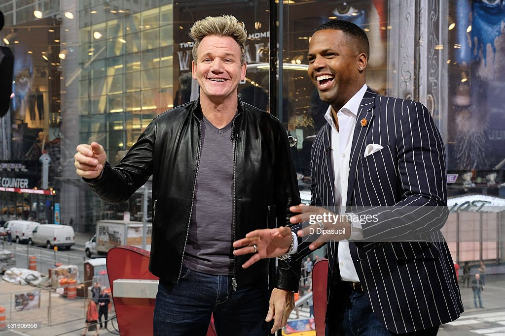 Calloway interviews Gordon Ramsay during his visit to 'Extra' at their New York studios at HM in Times Square on May 17 2016 in New York City