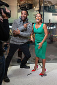 Calloway interviews Jada Pinkett Smith during her visit to 'Extra' at their New York studios at HM in Times Square on March 5 2015 in New York City