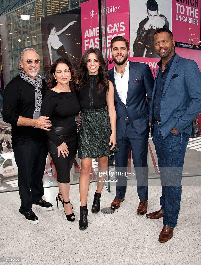 AJ Calloway interviews Josh Segarra, Ana Villafane, Gloria Estefan, and Emilio Estefan during their visit to 'Extra' at their New York Studios at H&M in Times Square on November 18, 2015 in New York City.
