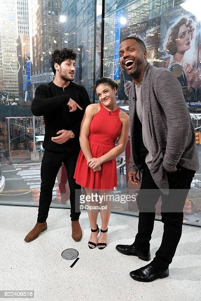 AJ Calloway interviews Laurie Hernandez and Val Chmerkovskiy during their visit to 'Extra' at their New York studios at HM in Times Square on...