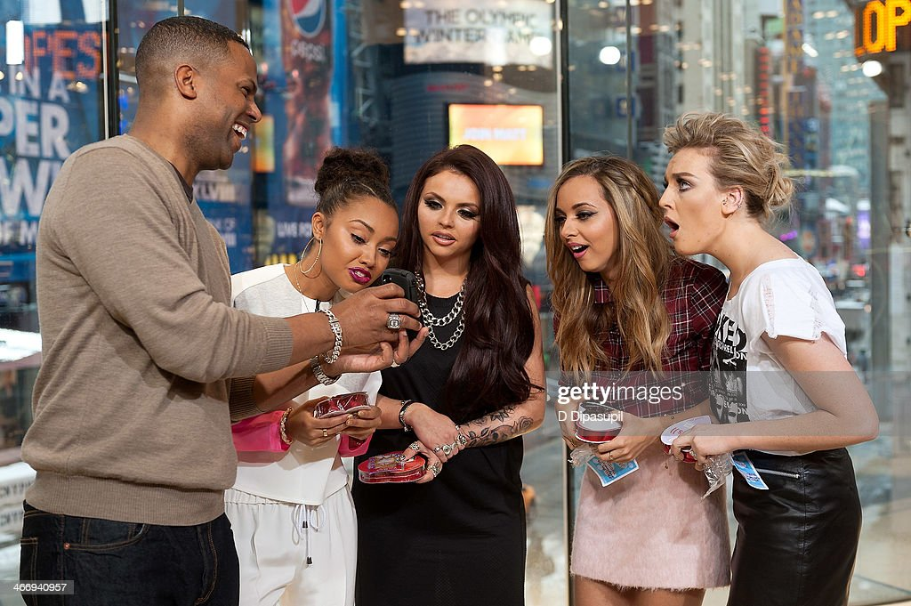 AJ Calloway interviews <a gi-track='captionPersonalityLinkClicked' href=/galleries/search?phrase=Leigh-Anne+Pinnock&family=editorial&specificpeople=8378207 ng-click='$event.stopPropagation()'>Leigh-Anne Pinnock</a>, <a gi-track='captionPersonalityLinkClicked' href=/galleries/search?phrase=Jesy+Nelson+-+Little+Mix&family=editorial&specificpeople=8378192 ng-click='$event.stopPropagation()'>Jesy Nelson</a>, <a gi-track='captionPersonalityLinkClicked' href=/galleries/search?phrase=Jade+Thirlwall&family=editorial&specificpeople=8378191 ng-click='$event.stopPropagation()'>Jade Thirlwall</a>, and <a gi-track='captionPersonalityLinkClicked' href=/galleries/search?phrase=Perrie+Edwards&family=editorial&specificpeople=8378323 ng-click='$event.stopPropagation()'>Perrie Edwards</a> of Little Mix during their visit to 'Extra' at their H&M Studio in Times Square on February 5, 2014 in New York City.