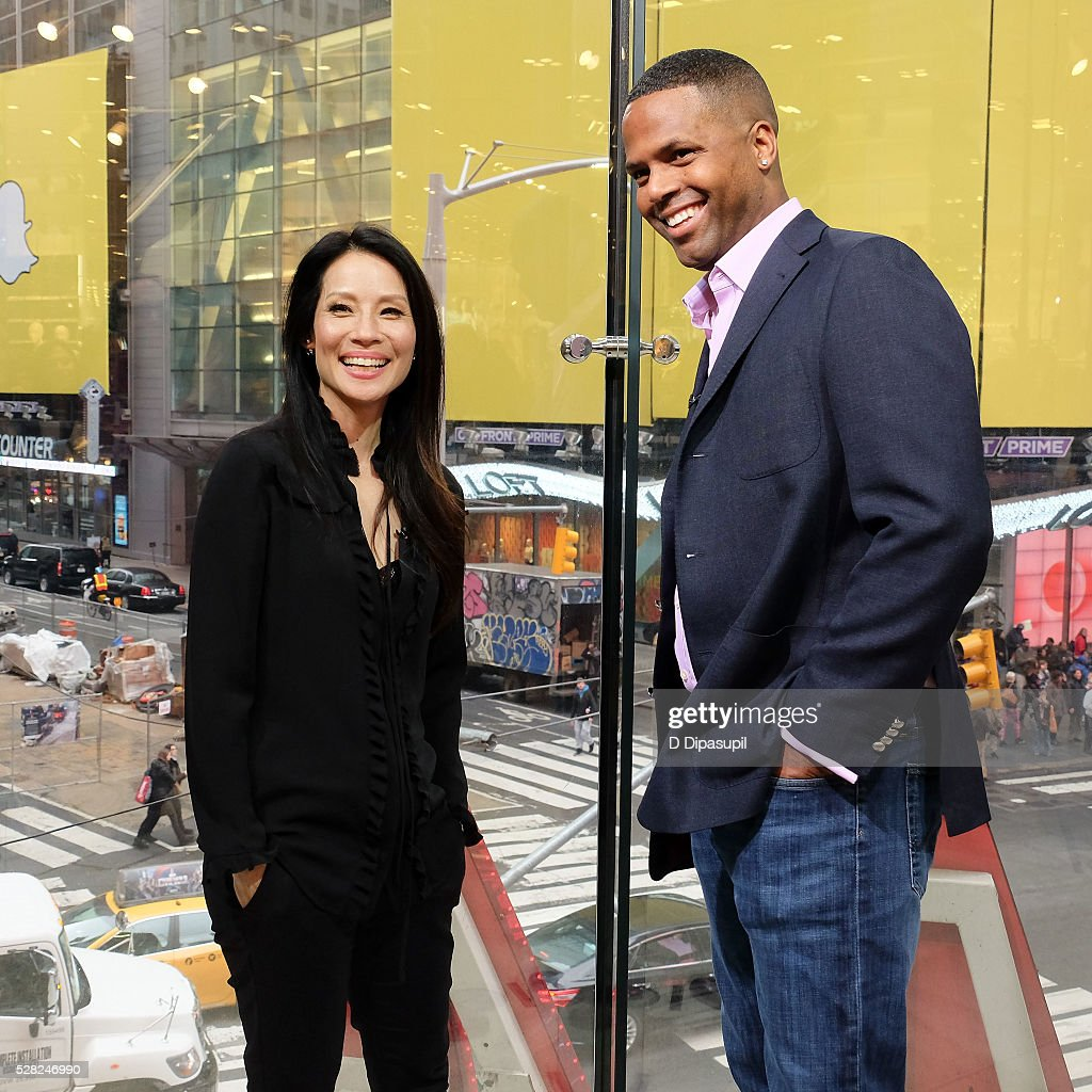 Calloway interviews Lucy Liu during her visit to 'Extra' at their New York studios at HM in Times Square on May 4 2016 in New York City