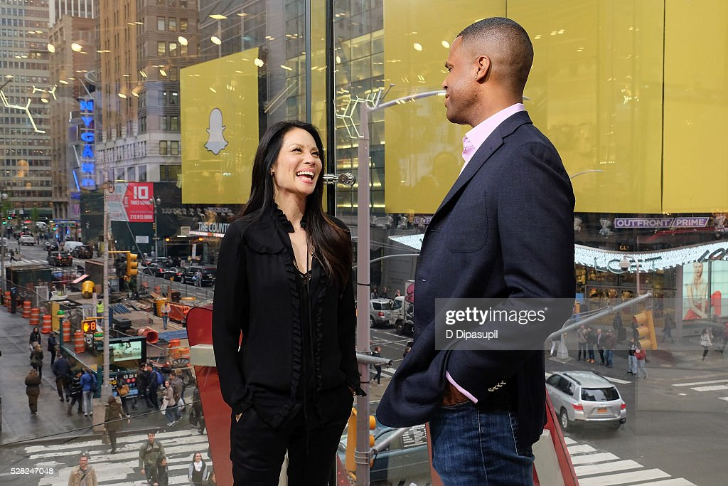 AJ Calloway (R) interviews <a gi-track='captionPersonalityLinkClicked' href=/galleries/search?phrase=Lucy+Liu&family=editorial&specificpeople=201874 ng-click='$event.stopPropagation()'>Lucy Liu</a> during her visit to 'Extra' at their New York studios at H&M in Times Square on May 4, 2016 in New York City.