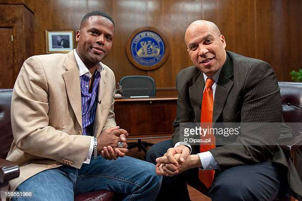 Calloway interviews Mayor Cory Booker during a taping of 'Extra' at Newark City Hall on January 15 2013 in Newark New Jersey