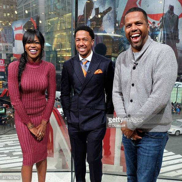 AJ Calloway interviews Nick Cannon and Amber Grimes during their visit to 'Extra' at their New York studios at HM in Times Square on March 28 2016 in...