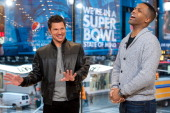 Calloway interviews Nick Lachey during his visit to 'Extra' at their HM Studio in Times Square on February 27 2014 in New York City
