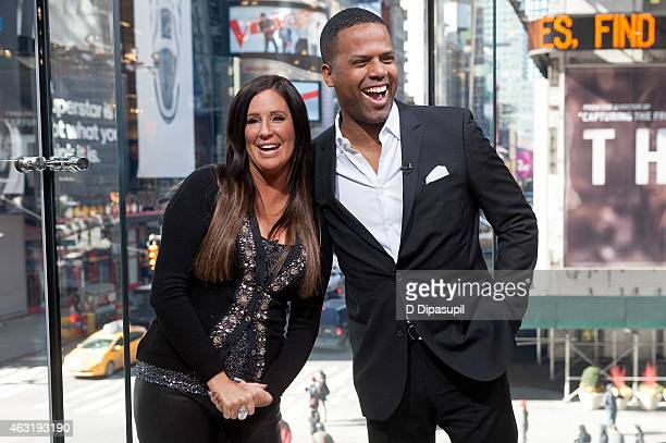 Calloway interviews Patti Stanger during her visit to 'Extra' at their New York studios at HM in Times Square on February 11 2015 in New York City