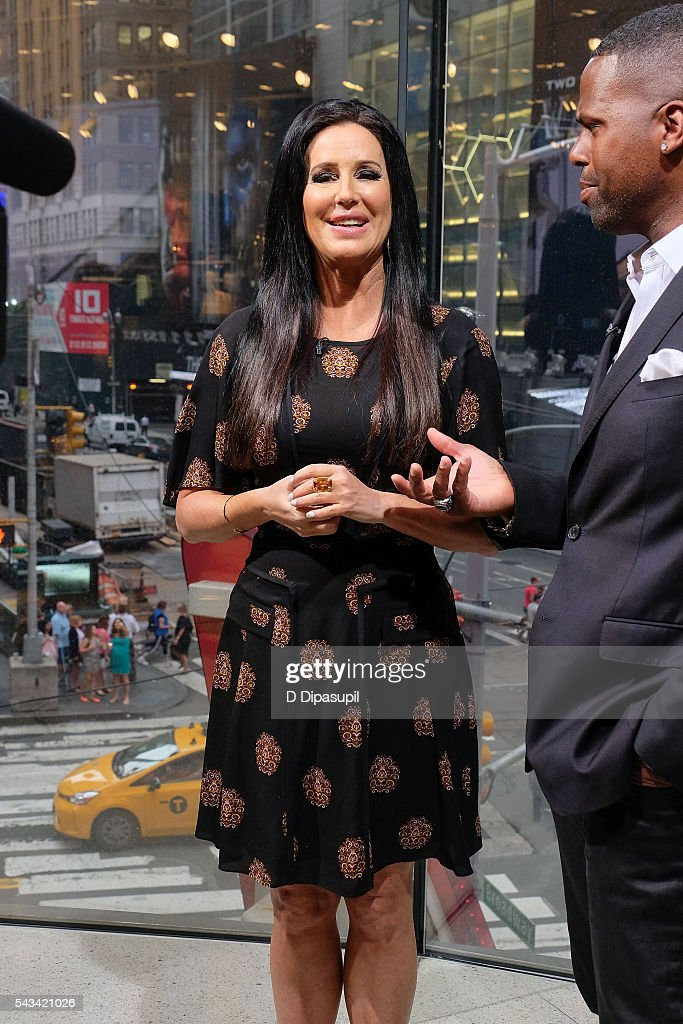 AJ Calloway (R) interviews Patti Stanger during her visit to 'Extra' at their New York studios at H&M in Times Square on June 28, 2016 in New York City.
