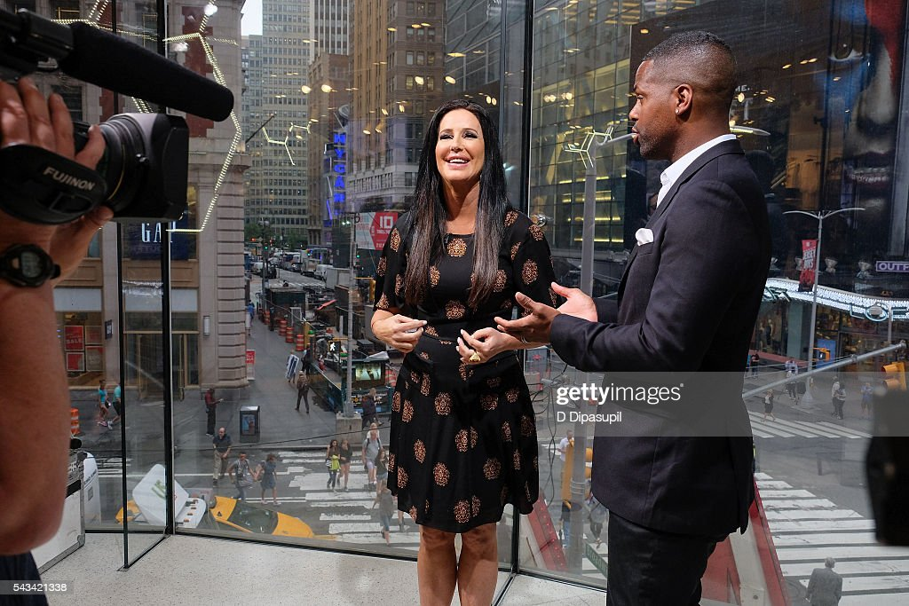 AJ Calloway (R) interviews <a gi-track='captionPersonalityLinkClicked' href=/galleries/search?phrase=Patti+Stanger&family=editorial&specificpeople=5446458 ng-click='$event.stopPropagation()'>Patti Stanger</a> during her visit to 'Extra' at their New York studios at H&M in Times Square on June 28, 2016 in New York City.