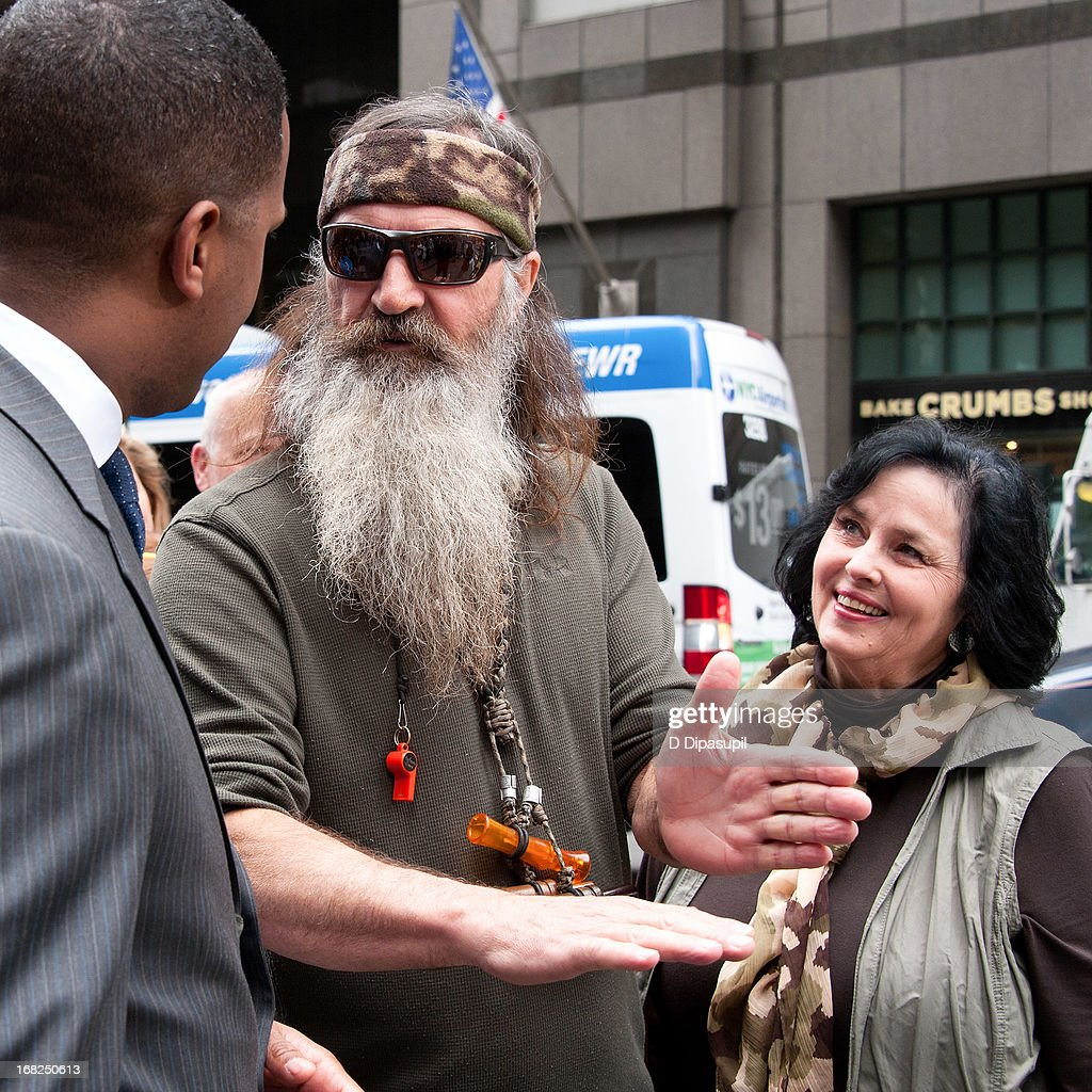 AJ Calloway interviews Phil Robertson and Kay Robertson during their visit to 'Extra' in Times Square on May 7, 2013 in New York City.