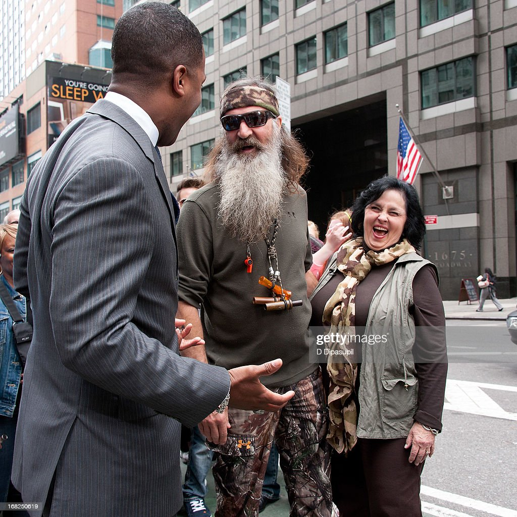 AJ Calloway interviews <a gi-track='captionPersonalityLinkClicked' href=/galleries/search?phrase=Phil+Robertson&family=editorial&specificpeople=4043277 ng-click='$event.stopPropagation()'>Phil Robertson</a> and Kay Robertson during their visit to 'Extra' in Times Square on May 7, 2013 in New York City.