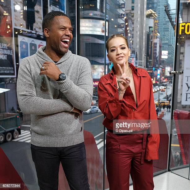Calloway interviews Rita Ora during her visit to 'Extra' at their New York studios at HM in Times Square on December 7 2016 in New York City