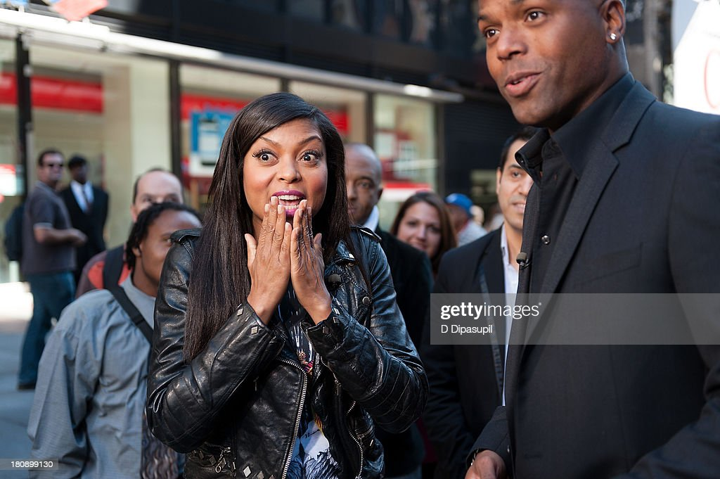 AJ Calloway (R) interviews <a gi-track='captionPersonalityLinkClicked' href=/galleries/search?phrase=Taraji+P.+Henson&family=editorial&specificpeople=208823 ng-click='$event.stopPropagation()'>Taraji P. Henson</a> during her visit to 'Extra' in Times Square on September 17, 2013 in New York City.