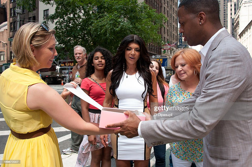 AJ Calloway (R) interviews Teresa Giudice (C) and Caroline Manzo of 'Real Housewives of New Jersey' during their visit to 'Extra' in Times Square on May 30, 2013 in New York City.