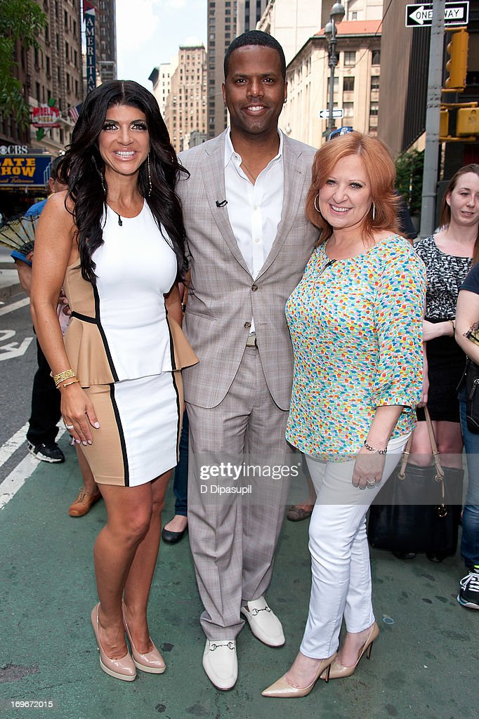 AJ Calloway (C) interviews <a gi-track='captionPersonalityLinkClicked' href=/galleries/search?phrase=Teresa+Giudice&family=editorial&specificpeople=5912953 ng-click='$event.stopPropagation()'>Teresa Giudice</a> (L) and <a gi-track='captionPersonalityLinkClicked' href=/galleries/search?phrase=Caroline+Manzo&family=editorial&specificpeople=5841102 ng-click='$event.stopPropagation()'>Caroline Manzo</a> of 'Real Housewives of New Jersey' during their visit to 'Extra' in Times Square on May 30, 2013 in New York City.