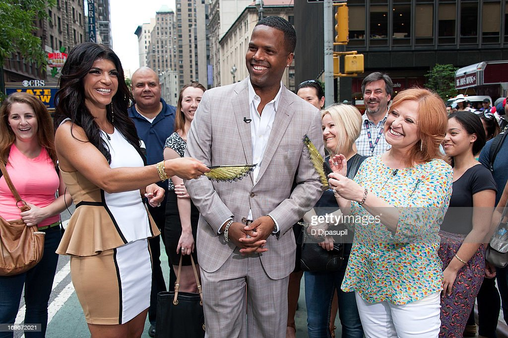 AJ Calloway (C) interviews Teresa Giudice (L) and Caroline Manzo of 'Real Housewives of New Jersey' during their visit to 'Extra' in Times Square on May 30, 2013 in New York City.