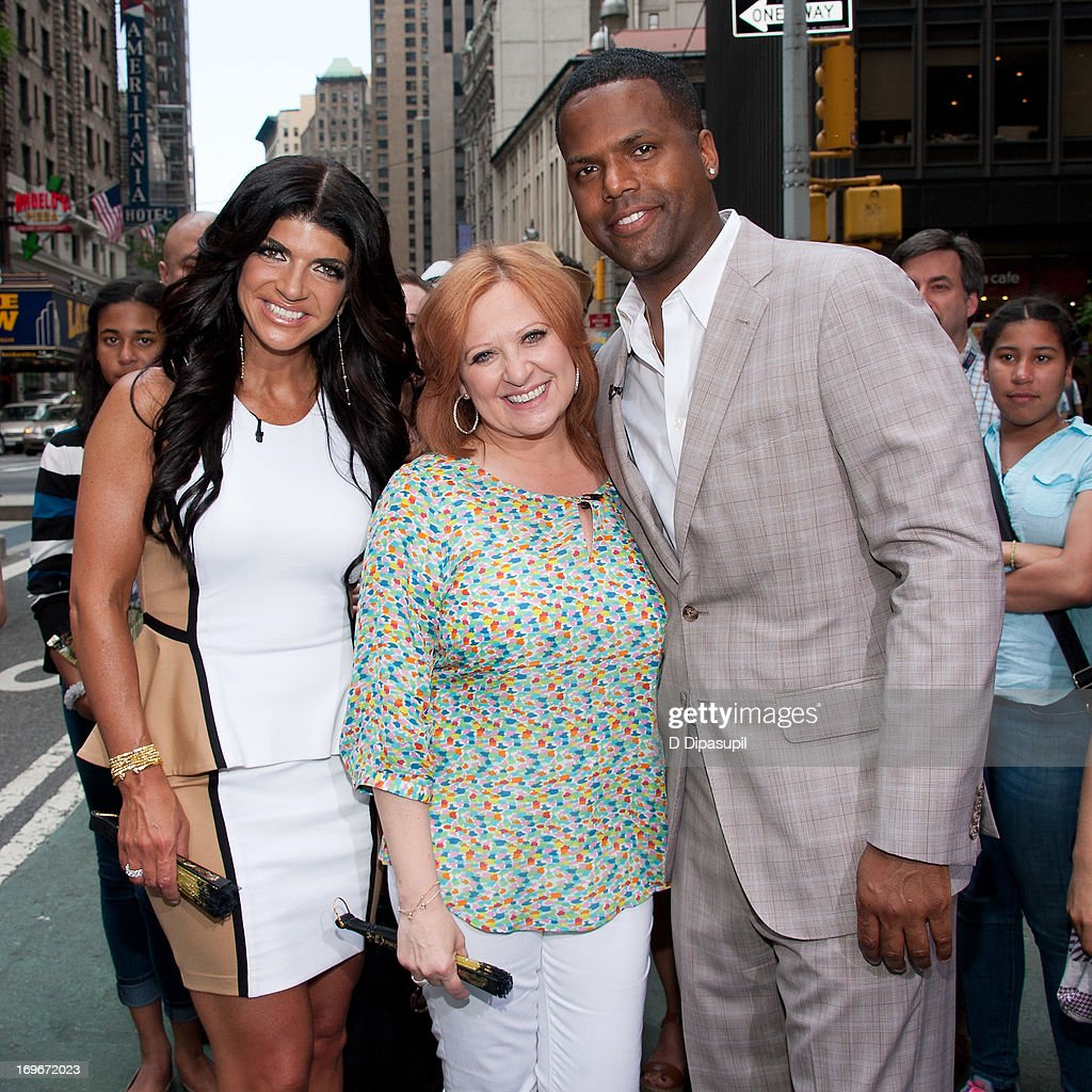 AJ Calloway (R) interviews Teresa Giudice (L) and Caroline Manzo of 'Real Housewives of New Jersey' during their visit to 'Extra' in Times Square on May 30, 2013 in New York City.