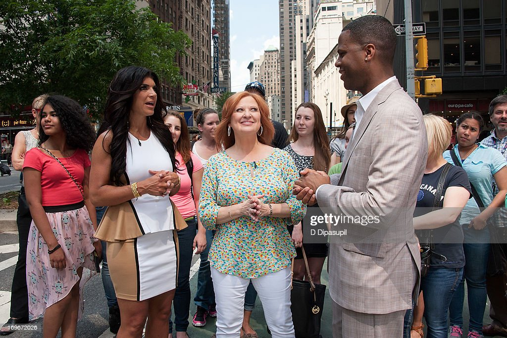 AJ Calloway (R) interviews <a gi-track='captionPersonalityLinkClicked' href=/galleries/search?phrase=Teresa+Giudice&family=editorial&specificpeople=5912953 ng-click='$event.stopPropagation()'>Teresa Giudice</a> (L) and <a gi-track='captionPersonalityLinkClicked' href=/galleries/search?phrase=Caroline+Manzo&family=editorial&specificpeople=5841102 ng-click='$event.stopPropagation()'>Caroline Manzo</a> of 'Real Housewives of New Jersey' during their visit to 'Extra' in Times Square on May 30, 2013 in New York City.