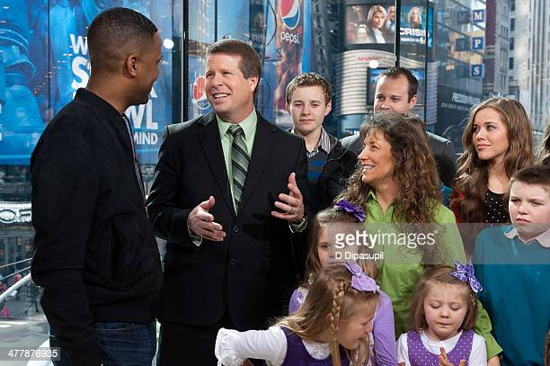 Calloway interviews the Duggar family during their visit to 'Extra' at their New York studios at HM in Times Square on March 11 2014 in New York City