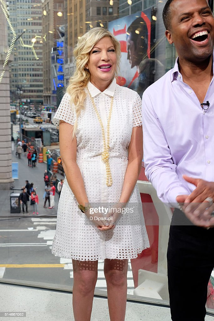 Calloway interviews Tori Spelling during her visit to 'Extra' at their New York studios at HM in Times Square on March 10 2016 in New York City