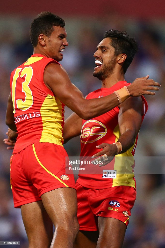 Callum Ah Chee and Aaron Hall of the Suns celebrate a goal during the round two AFL match between the Fremantle Dockers and the Gold Coast Suns at...