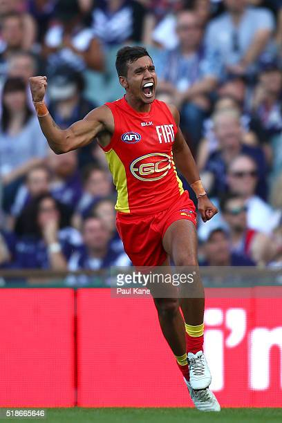 Callum Ah Chee of the Suns celebrates a goal during the round two AFL match between the Fremantle Dockers and the Gold Coast Suns at Domain Stadium...