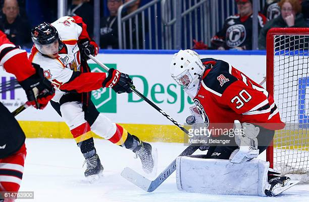 Callum Booth makes a save on D'Artagnan Joly of the Baie Comeau Drakkar during their QMJHL hockey game at the Centre Videotron on October 14 2016 in...