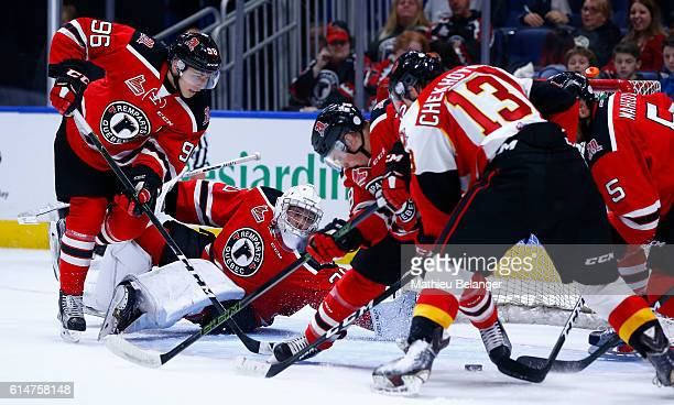 Callum Booth of the Quebec Remparts dives to make a save against the Baie Comeau Drakkar during their QMJHL hockey game at the Centre Videotron on...