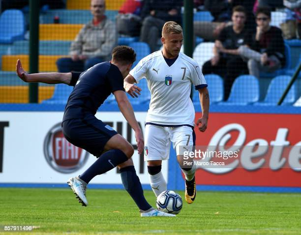 Callum Brittain of England U20 competes for the ball with Giuseppe Antonio Panico of Italy U20 during the 8 Nations Tournament match between Italy...