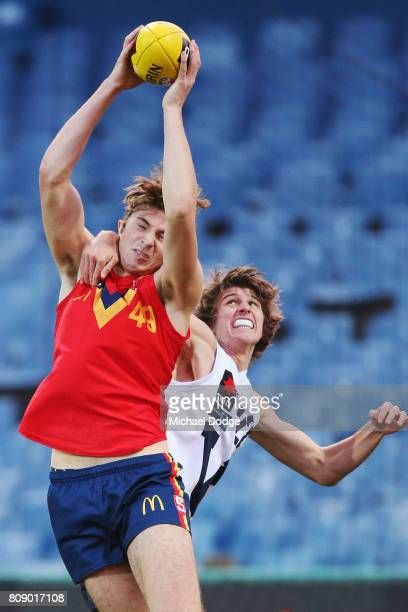 Callum ColemanJones of South Australia marks the ball against Jordan BUTTS of Vic Country during the U18 AFL Championships match between Vic Country...