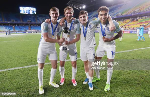 Callum Connolly Kieran Dowell Jonjoe Kenny and Dominic CalvertLewin of England celebrate with the trophy after the FIFA U20 World Cup Korea Republic...