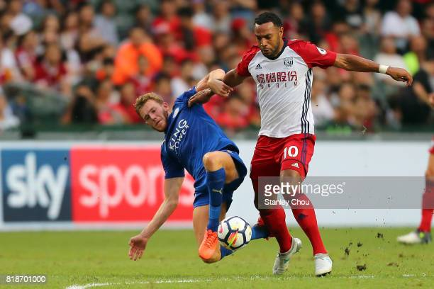 Callum Elder of Leiceister City tackles Matt Phillips of West Bromwich Albion during the Premier League Asia Trophy match between Leicester City and...