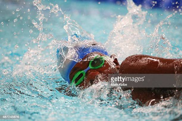 Callum Ellick of Saint Helena competes in the boys 100m freestyle preliminaries at the aquatic centre of the Tuanaimato Sports Facility on day two of...