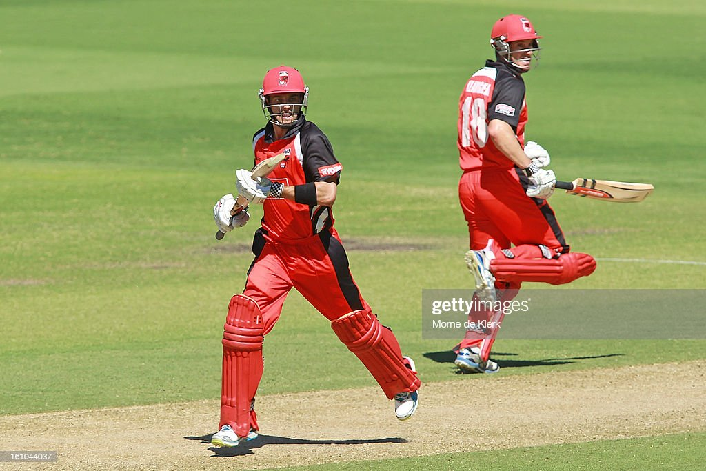 Callum Ferguson (L) and Michael Klinger (R) of the Redbacks runs between the wicket during the Ryobi One Cup Day match between the South Australian Redbacks and the Victorian Bushrangers at Adelaide Oval on February 9, 2013 in Adelaide, Australia.