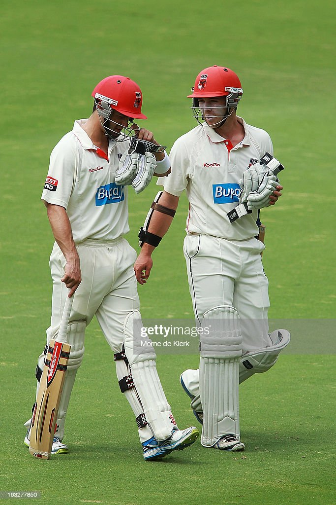 Callum Ferguson and Travis Head of the Redbacks leave the field at lunch during day one of the Sheffield Shield match between the South Australian redbacks and the Western Australia Warriors at Adelaide Oval on March 7, 2013 in Adelaide, Australia.