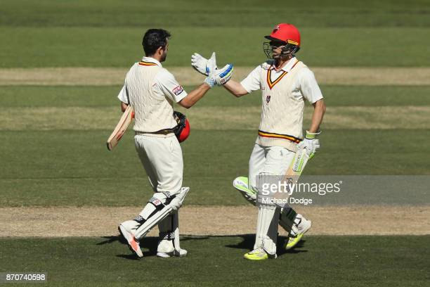 Callum Ferguson of South Australia celebrates his century with Jake Lehmann during day three of the Sheffield Shield match between Victoria and South...