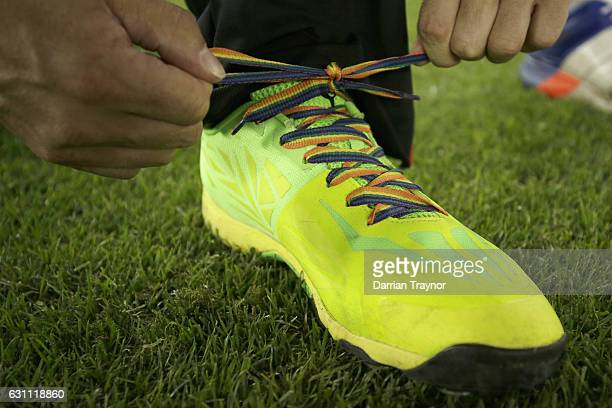 Callum Ferguson of the Melbourne Renegades ties up his 'Rainbow' laces in suport of Zaidee's Rainbow Foundation before the Big Bash League match...