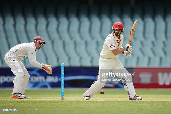 Callum Ferguson of the Redbacks bats in front of Chris Hartley of the Bulls during day three of the Sheffield Shield match between South Australia...